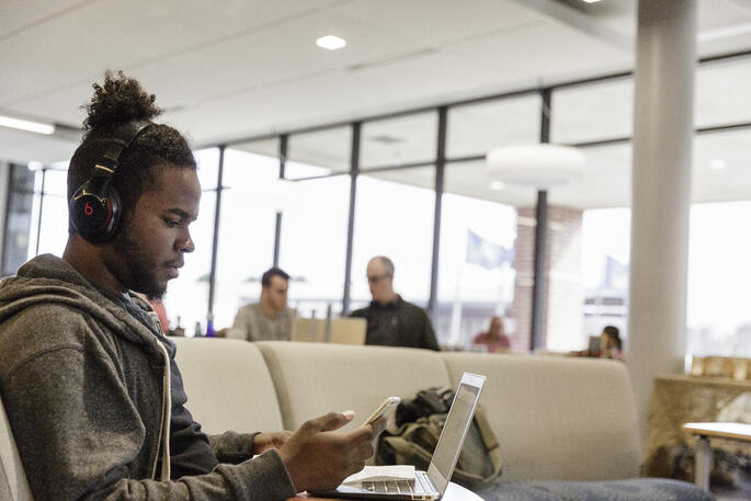 ncc-student-studying-at-library