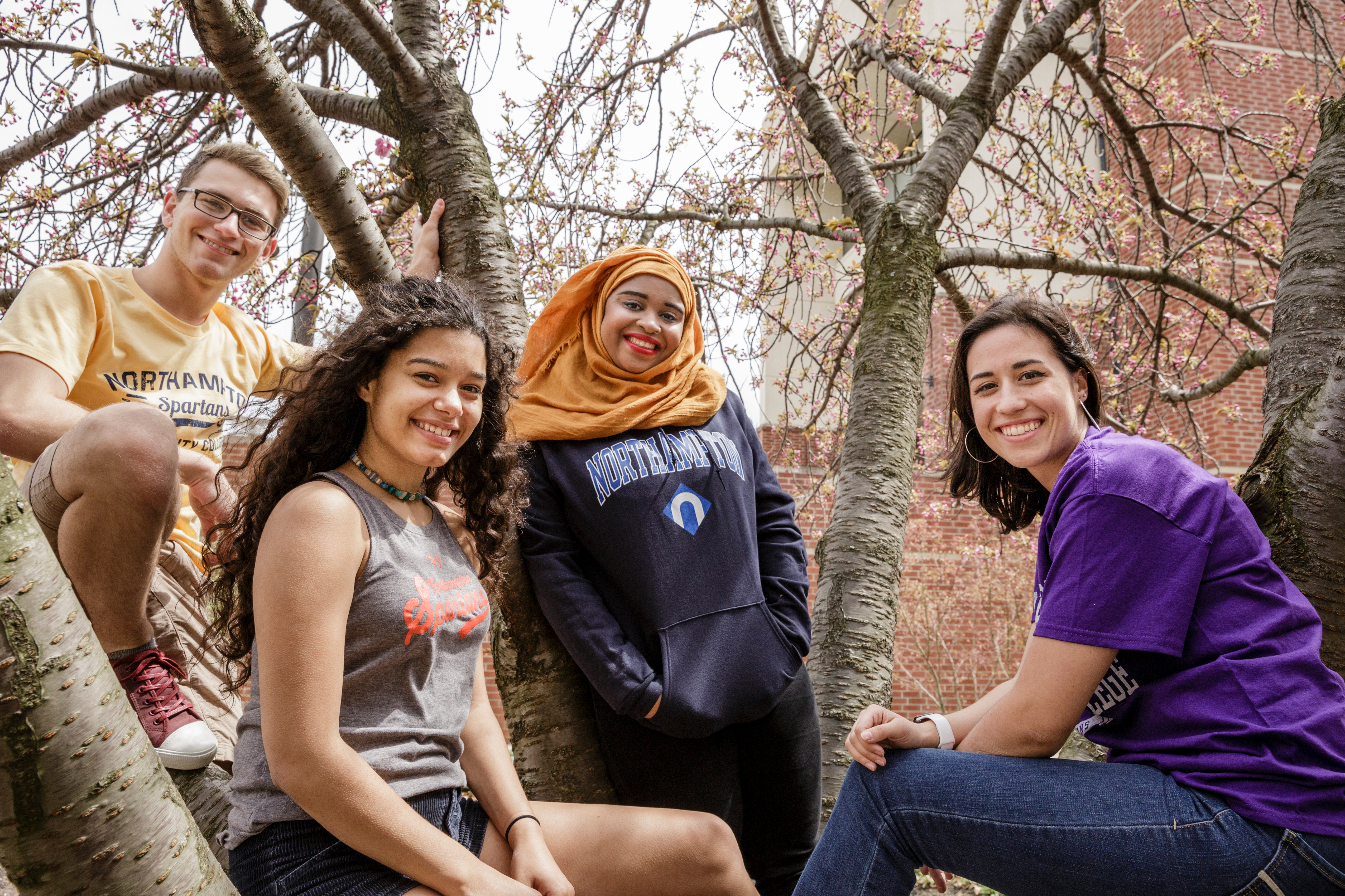 NCC students smiling in tree